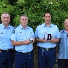 New Police Southern District Commander Inspector Paul Basham (left) presented long service awards...