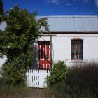 A working group wants to see the historic Vallance Cottage future-proofed. Photo: Jono Edwards.