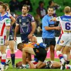 Alex McKinnon receives attention after the tackle. Photo Getty