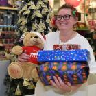Kmart Wishing Tree Appeal co-ordinator Dawn Barnes with some of the presents destined for...