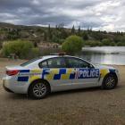 A police car parks at the Bannockburn inlet, the Kawarau arm of Lake Dunstan. Photo: Jono Edwards