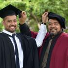 Marckis Schaaf (22) and his father  Matani (47), both of Dunedin, graduate from the University of...