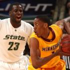 Paul Carter (with ball) plays at the University of Minnesota, while being guarded by now-Golden...