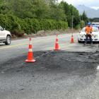 A blackened State Highway 6, near Lake Hayes, after a three-car crash yesterday. Photos: David...
