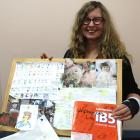 Author Vivien Adams and the storyboard she used to plan her novel Unplayable Lie. Photo: Joshua...