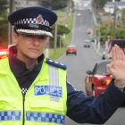 Southern road policing manager Inspector Tania Baron stops traffic in Dunedin's Eglinton Rd this...