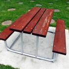 The picnic table set to stay near the Falling Leaves sculpture on the corner of Gordon and...