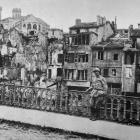 The effects of German bombardment on a picturesque corner of the town of Verdun. — Otago Witness,...