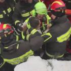Rescuers with a survivor of the avalanche at Hotel Rigopiano in Farindola, central Italy. Photo...