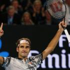 Roger Federer celebrates his win over Stan Wawrinka. Photo Reuters