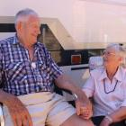 Alexandra couple Doug and Margaret Paterson sit outside the motorhome they use to traverse the...