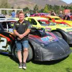 Central Motor Speedway promoter Graham Williamson with a line of super saloon cars in Cromwell....