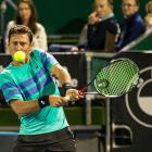 Artem Sitak plays a shot at the ASB Classic. Photo: Getty Images