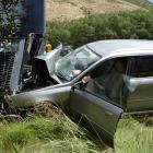 A family escaped serious injury after this car and bus collided on the Lindis Pass yesterday....