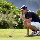 Duncan Croudis (Otago) lines up his putt on the 18th hole during the New Zealand Open regional...