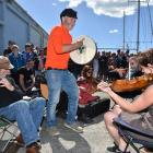 Enda O'Coineen joins in a jig with the Dunedin Scottish Fiddle Club before setting off on his...