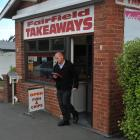 A detective leaves Fairfield Takeaways, which was the target of an attempted robbery last night....