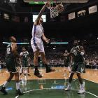 Steven Adams slam dunks the ball for the Oklahoma City Thunder against the Milwaukee Bucks. Photo...