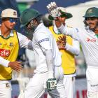 Bangladesh's Shakib Al Hasan is congratulated by teammates as he leaves the field after being...