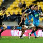 Melani Nanai makes a break for the Blues against the Hurricanes. Photo: Getty Images