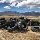 Unusable tyres are piled on Richard Subtil's Omarama Station after they were slashed at the...
