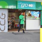 BP 2Go Oval service station attendant Anmol Singh begins the clean-up after a ram-raid yesterday...