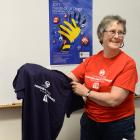 University of Otago Hands-on at Otago co-ordinator Sandra Copeland gets T-shirts ready for the...