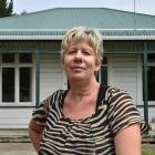 Dunedin woman Tania Deaker has been unable to return to her home (pictured) for almost a year...