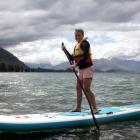 With his life jacket on, Harry McFarlane paddleboards on Lake Wanaka yesterday afternoon. Photo...