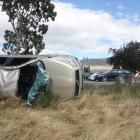 A Toyota Rav4 lies on its side after a crash on State Highway 8 between Tarras and Cromwell, near...
