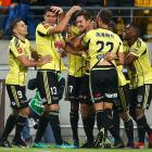 Wellington Phoenix players celebrate Jacob Tratt's goal in their win over the Melbourne Victory....