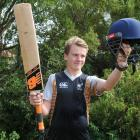 Xavier Chisholm with the tools of his trade, given to him by New Zealand cricketer Neil Broom....