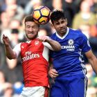 Arsenal's Shkodran Mustafi (L) in action with Chelsea's Diego Costa. Photo: Reuters