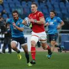 Wales' George North runs in to score a try against Italy. Photo Reuters