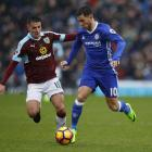 Chelsea's Eden Hazard (R) in action with Burnley's Ashley Westwood. Photo Reuters