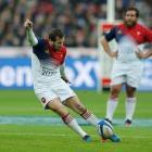Camille Lopez kicks a penalty for France against Scotland. Photo Reuters