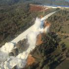 A damaged spillway with eroded hillside is seen in an aerial photo taken over the Oroville Dam in...