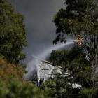 Fire crews battle the blaze at the recycling plant in Sydney. Photo Reuters