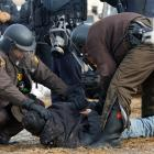 Police arrested protesters as they cleared the Pipe line campsite. Photo: Reuters