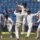 Australian players celebrate after winning the match. Photos: Reuters