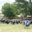 Mourners gather as two helicopters prepare to lift the casket of Cromwell teacher Anne Cook from...