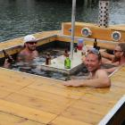 ''Party boat'' inventor Anthony Robertson (facing camera), of Pisa Moorings, takes his creation...