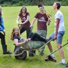 Aquinas College residential assistants  (from left) Jess Bell (21), Alesha East (20), Lucy...