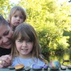 Rebekah Fraser and her children Eva (3) and Lily (1)  have been painting and searching for rocks...
