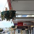 A withered flower basket in  Clyde St,  Balclutha. Photo: Samuel White.