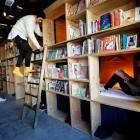 "Cabins are seen inside ""Book And Bed"", a bookshop-themed capsule hotel, in Tokyo, Japan. Photo:..."