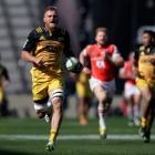 Brad Shields on the run for the Hurricanes during their big win over the Sunwolves on Saturday....