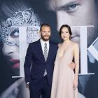 Jamie Dornan (Christian Grey) and Dakota Johnson (Ana Steele) at the premiere of the film 'Fifty...