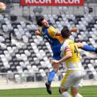 Southern United striker Eric Molloy heads the ball on ahead of Eastern Suburbs defender Ross...