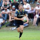 Ben Smith on the attack for the Highlanders during a Super Rugby trial match against the Waratahs...
